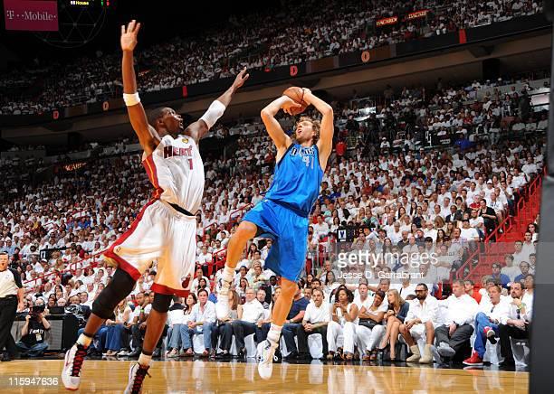 Dirk Nowitzki of the Dallas Mavericks shoots over Chris Bosh of the Miami Heat during Game Six of the 2011 NBA Finals on June 12 2011 at the American...