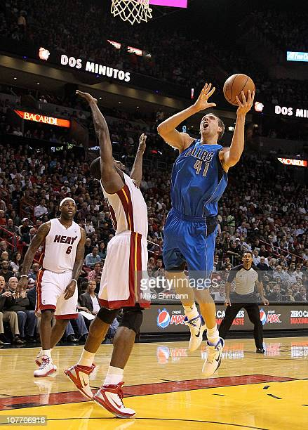 Dirk Nowitzki of the Dallas Mavericks shoots over Joel Anthony of the Miami Heat during a game at American Airlines Arena on December 20 2010 in...