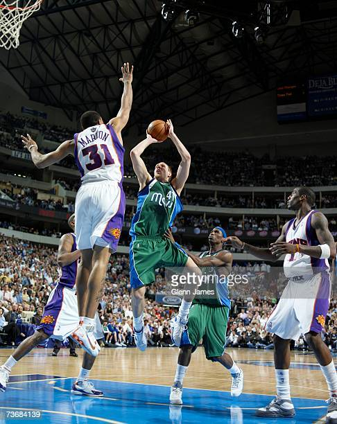 Dirk Nowitzki of the Dallas Mavericks shoots over Shawn Marion of the Phoenix Suns on March 14 2007 at the American Airlines Center in Dallas Texas...