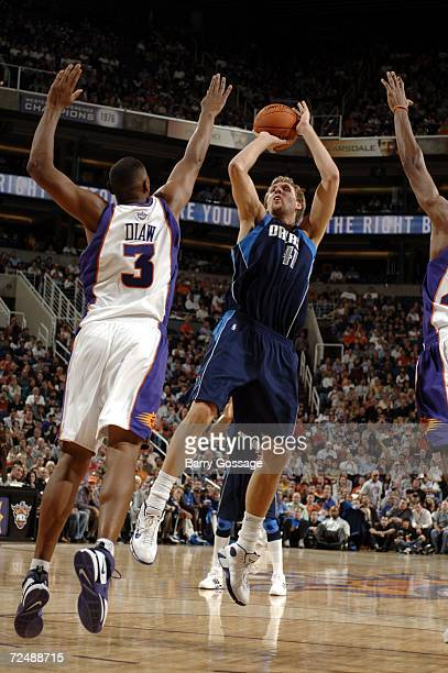 Dirk Nowitzki of the Dallas Mavericks shoots over the block of Boris Diaw of the Phoenix Suns in an NBA game played on November 9 at U.S. Airways...