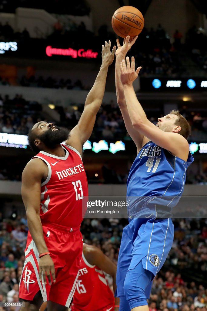 Dirk Nowitzki #41 of the Dallas Mavericks shoots the ball against James Harden #13 of the Houston Rockets in the first half at American Airlines Center on January 24, 2018 in Dallas, Texas.