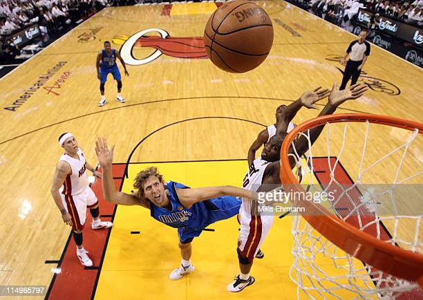 Dirk Nowitzki of the Dallas Mavericks shoots the ball against Joel Anthony of the Miami Heat in the first quarter in Game One of the 2011 NBA Finals...