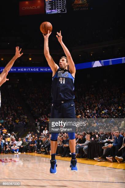 Dirk Nowitzki of the Dallas Mavericks shoots the ball against the Golden State Warriors on December 14 2017 at ORACLE Arena in Oakland California...