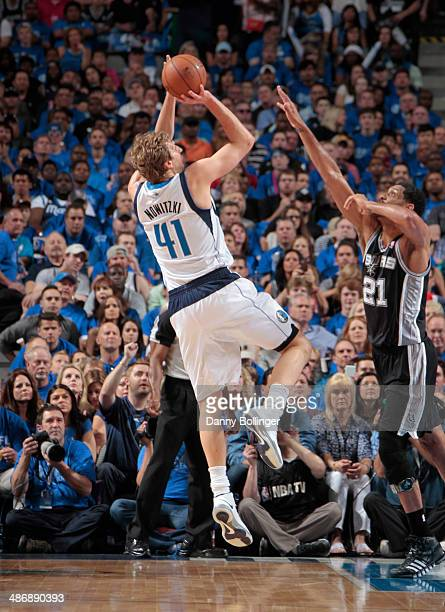 Dirk Nowitzki of the Dallas Mavericks shoots the fadeaway against Tim Duncan of the San Antonio Spurs during Game Three of the Western Conference...