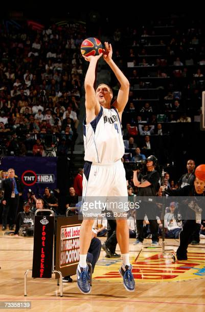 Dirk Nowitzki of the Dallas Mavericks shoots the money ball during the Footlocker ThreePoint Shootout at NBA AllStar Weekend on February 17 2007 at...