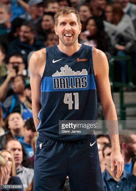Dirk Nowitzki of the Dallas Mavericks smiles during the game against the New Orleans Pelicans on December 26 2018 at the American Airlines Center in...