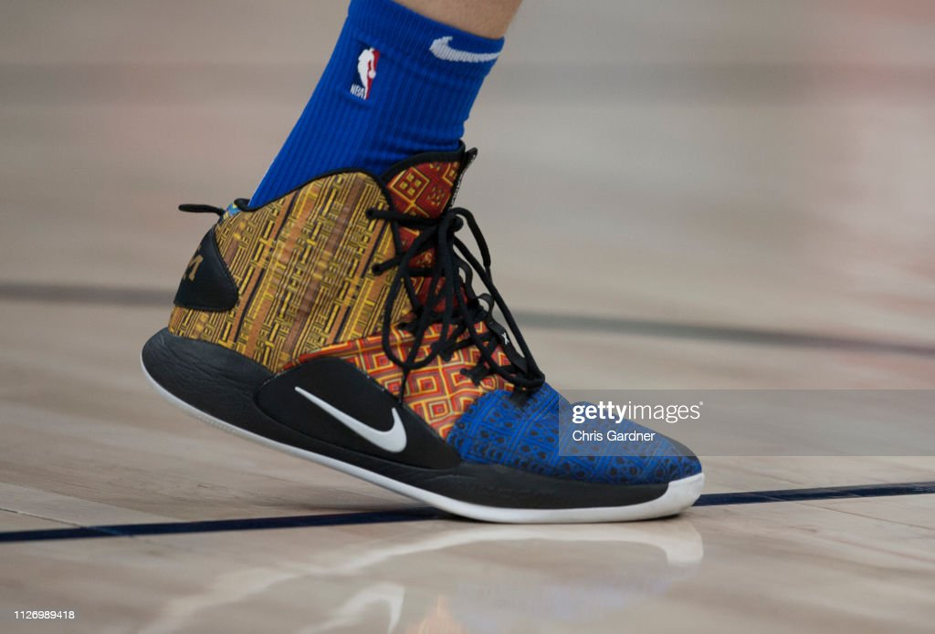 detailed look d3697 3202f Dirk Nowitzki of the Dallas Mavericks sports his Nike ...