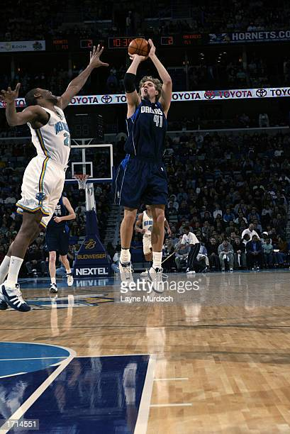 Dirk Nowitzki of the Dallas Mavericks takes a jump shot over Jamaal Magloire of the New Orleans Hornets during the game at New Orleans Arena on...