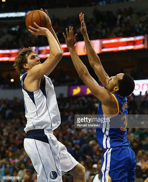 Dirk Nowitzki of the Dallas Mavericks takes a shot against Shaun Livingston of the Golden State Warriors at American Airlines Center on December 30...