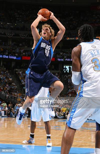Dirk Nowitzki of the Dallas Mavericks takes a shot against the Denver Nuggets during Game One of the Western Conference Semifinals during the 2009...