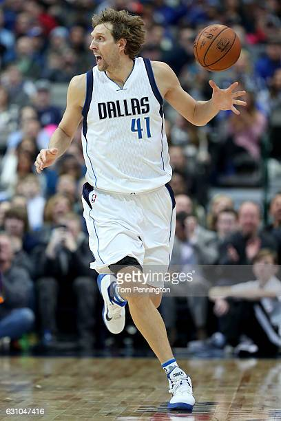 Dirk Nowitzki of the Dallas Mavericks takes control of the ball against the Phoenix Suns in the second half at American Airlines Center on January 5...