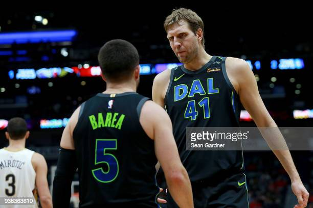 Dirk Nowitzki of the Dallas Mavericks talks with JJ Barea during the second half of a NBA game against the New Orleans Pelicans at the Smoothie King...
