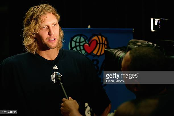 Dirk Nowitzki of the Dallas Mavericks talks with the media at the TMobile Rookie Challenge and Youth Jam TipOff Event announcement assembly at Hector...