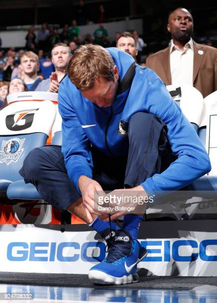 Dirk Nowitzki of the Dallas Mavericks ties her shoes before the game against the Indiana Pacers on February 26 2018 at the American Airlines Center...