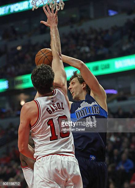 Dirk Nowitzki of the Dallas Mavericks turns to pass under pressure from Pau Gasol of the Chicago Bulls at the United Center on January 15 2016 in...