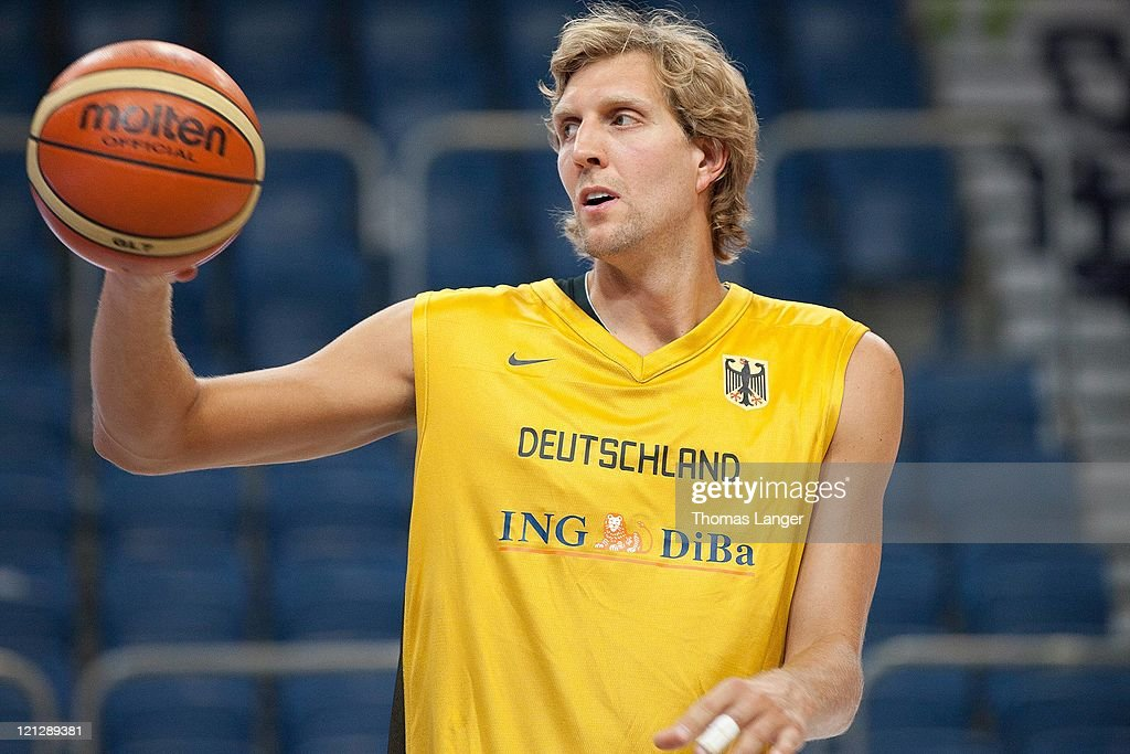 Dirk Nowitzki of the German national basketball team holds the ball during a public training session at the Stechert-Arena on August 17, 2011 in Bamberg, Germany.