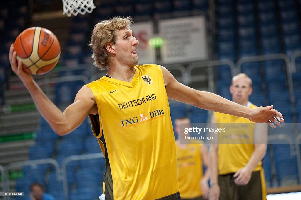 Dirk Nowitzki of the German national basketball team throws the ball during a public training session at the Stechert-Arena on August 17, 2011 in Bamberg, Germany.