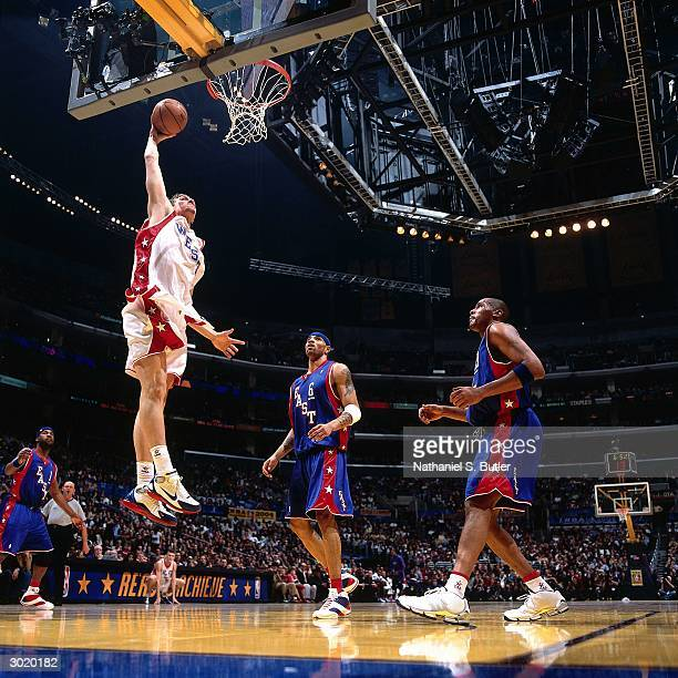 Dirk Nowitzki of the Western Conference AllStars dunks against the Eastern Conference AllStars during the 2004 AllStar Game on February 15 2004 at...