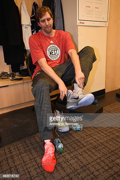 Dirk Nowitzki of the Western Conference AllStars puts on his sneakers in the locker room prior to the game against the Eastern Conference AllStar in...