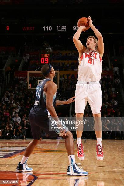 Dirk Nowitzki of the Western Conference attempts a shot against Paul Pierce of the Eastern Conference during the 58th NBA AllStar Game part of 2009...