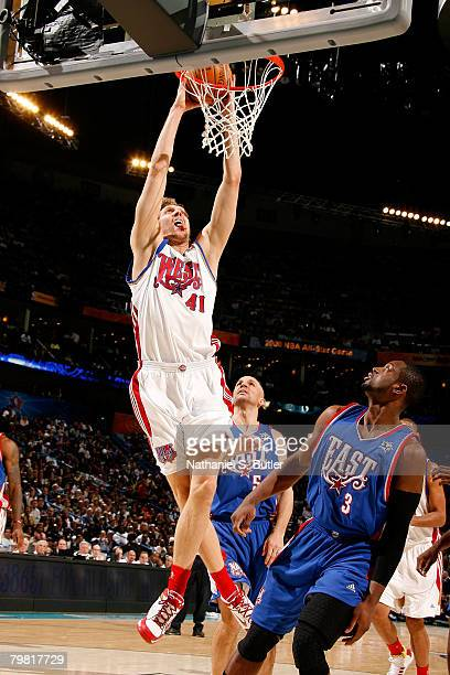 Dirk Nowitzki of the Western Conference dunks against Dwyane Wade of the Eastern Conference during the 2008 NBA AllStar Game part of 2008 NBA AllStar...