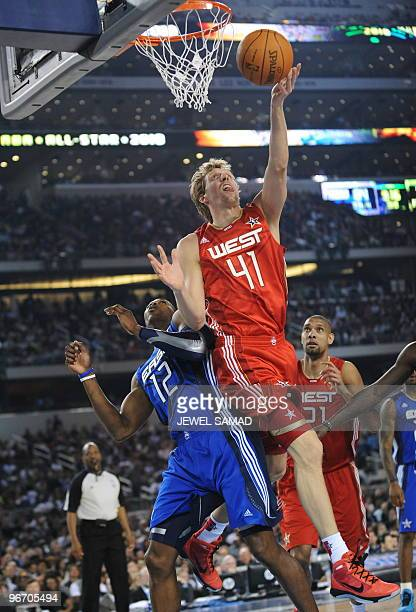 Dirk Nowitzki of the Western Conference shoots against Dwight Howard of the Eastern Conference during the third quarter of the NBA AllStar Game part...