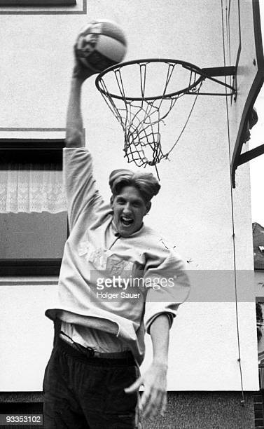 Dirk Nowitzki plays basketball in front of his parent's house on May 7 1996 in Wuerzburg Germany