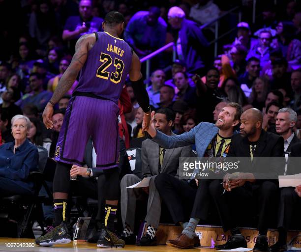 Dirk Nowitzki shakes hands with LeBron James of the Los Angeles Lakers during the first half at Staples Center on November 30 2018 in Los Angeles...