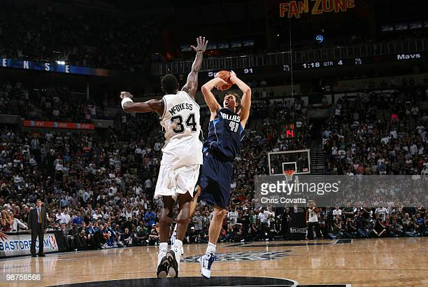 Dirk Nowitzki the Dallas Mavericks shoots over Antonio McDyess of the San Antonio Spurs in Game Six of the Western Conference Quarterfinals during...