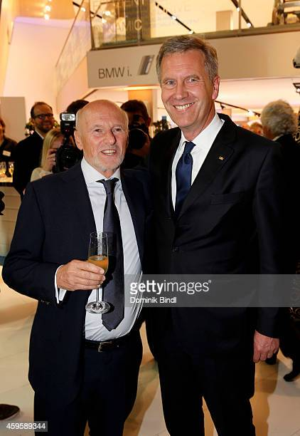 Dirk Rossmann and Christian Wulff attend the Querdenker Award 2014 at BMW World on November 25 2014 in Munich Germany