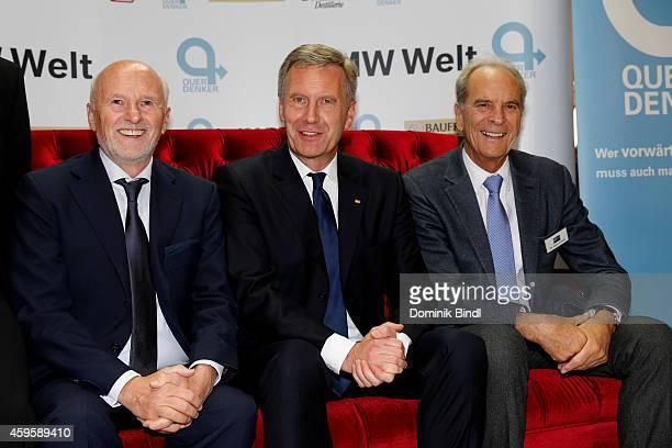 Dirk Rossmann Christian Wulff and Juergen Heraeus attend the Querdenker Award 2014 at BMW World on November 25 2014 in Munich Germany