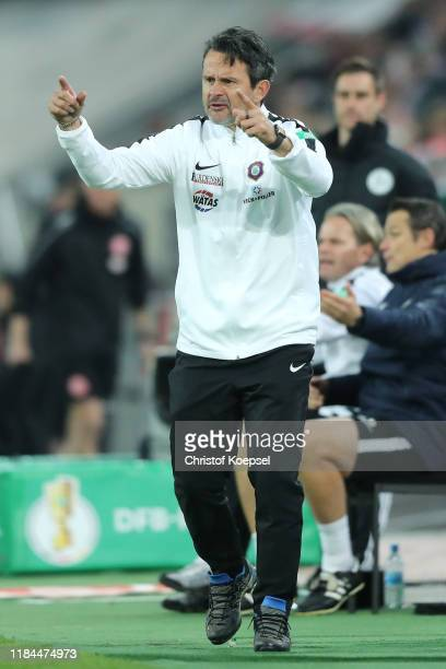 Dirk Schuster head coach of Erzgebirge Aue reacts during the DFB Cup second round match between Fortuna Duesseldorf and Erzgebirge Aue at Merkur...