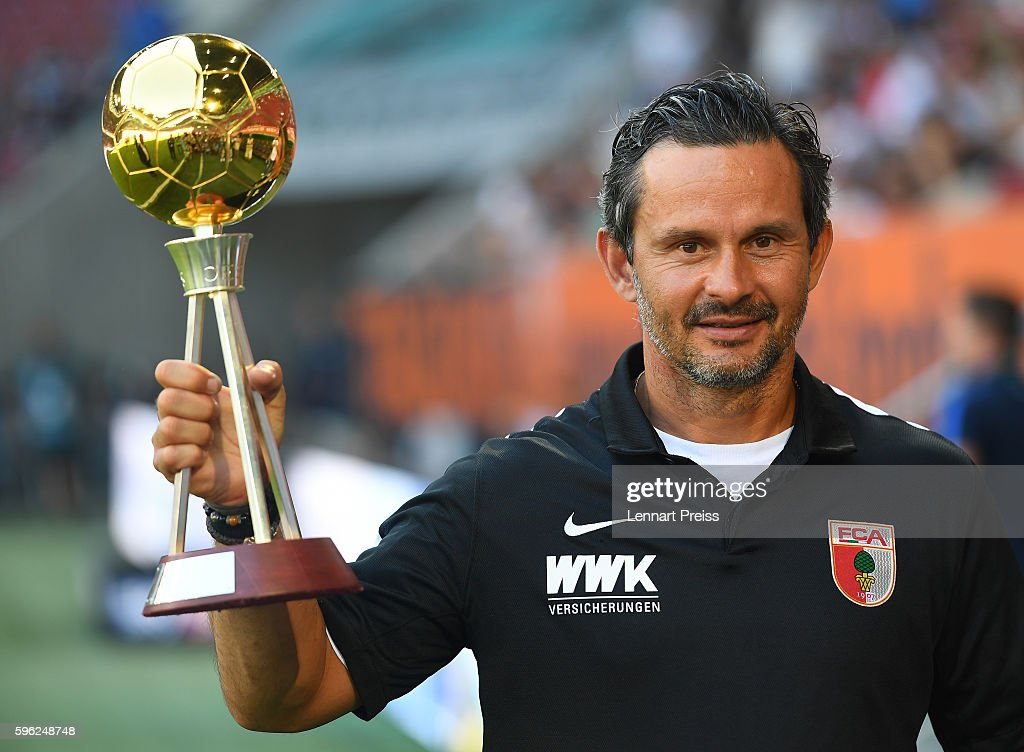 Dirk Schuster, head coach of FC Augsburg is awarded as 'coach of the year' by magazine Kicker prior to the Bundesliga match between FC Augsburg and VfL Wolfsburg at WWK Arena on August 27, 2016 in Augsburg, Germany.
