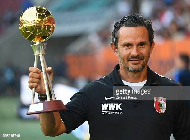 Dirk Schuster head coach of FC Augsburg is awarded as 'coach of the year' by magazine Kicker prior to the Bundesliga match between FC Augsburg and...