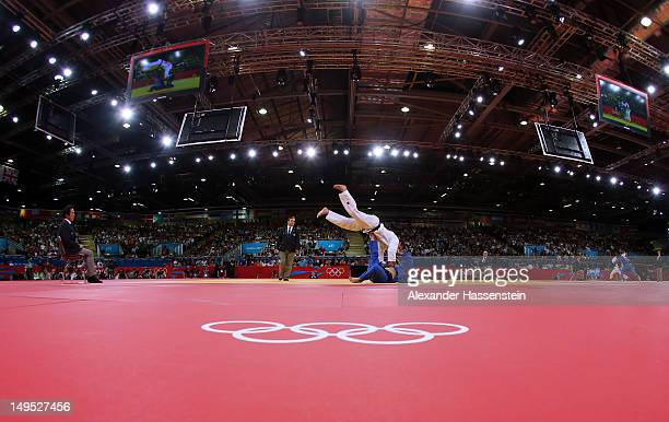 Dirk Van Tichelt of Belgium competes with Nicholas Delpopolo of the United States in the Men's 73 kg Judo on Day 3 of the London 2012 Olympic Games...