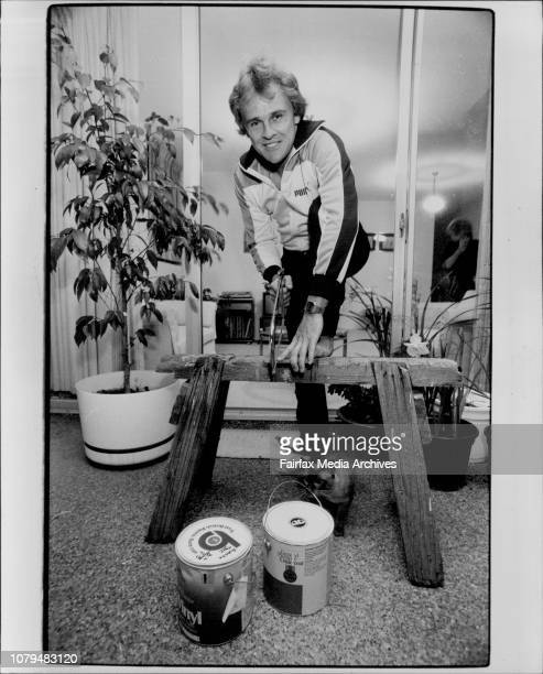 Dirk Wellham cricketer seen here at his home at 3/7 Morrison rd Gladesville being the busy home handiman that he is September 21 1983