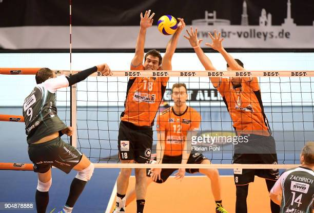 Dirk Westphal of SWD Dueren Pierre Pujol and Graham Vigrass of the Berlin Recycling Volleys during the game between the Berlin Recycling Volleys and...