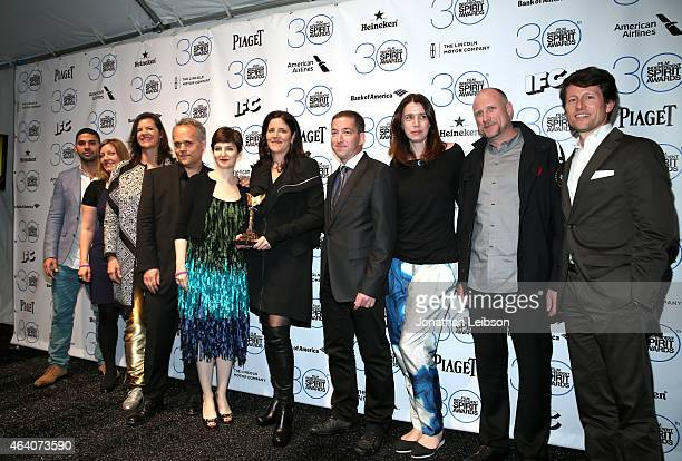 Dirk Wilutzky Mathilde Bonnefoy Laura Poitras Glenn Greenwald and the cast and crew of Citizenfour pose in the press room with the award for best...