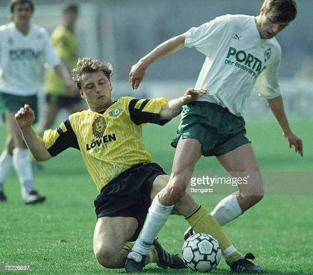 Dirk Zander of Dresden and Manfred Bockenfeld of Bremen fight for the ball during the Bundesliga match between Werder Bremen and Dynamo Dresden at...