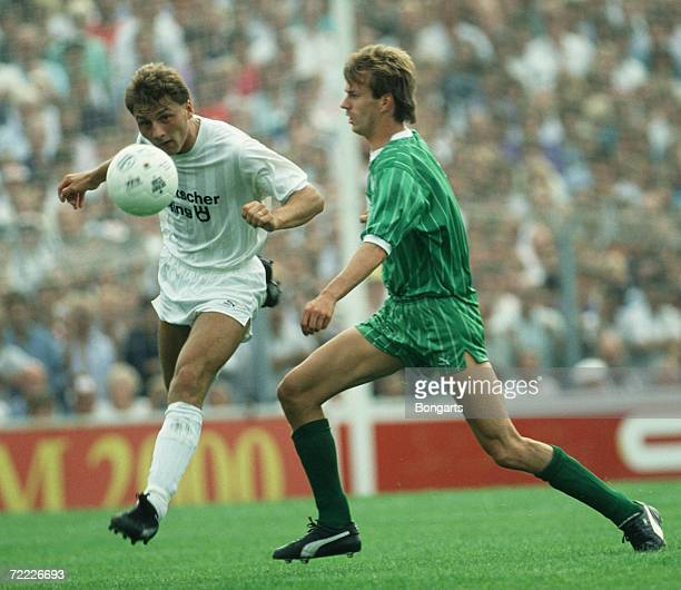 Dirk Zander of St Pauli and Manfred Bockenfeld of Bremen fight for the ball during the Bundesliga match between FC St Pauli and Werder Bremen at the...