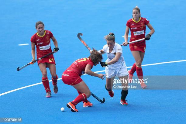 Dirkie Chamberlain of South Africa battles with Lola Riera of Spain during the Pool C game between Spain and South Africa of the FIH Womens Hockey...