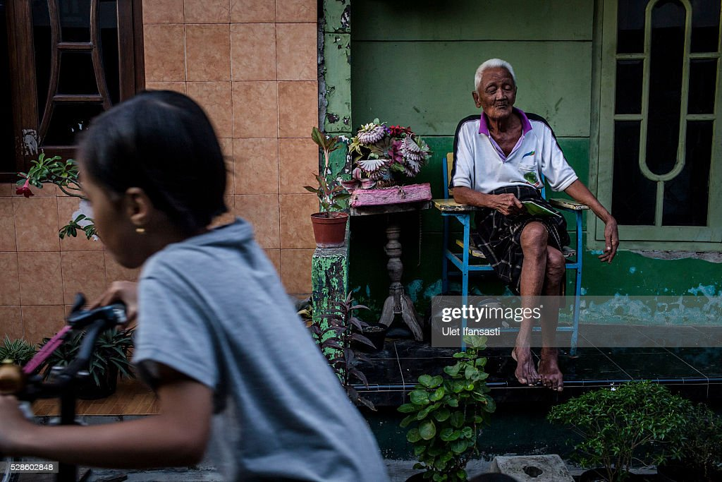 Dirman, 95 years old, sits infront his house on May 05, 2016 in Kendal, Central Java. Dirman, was a worker, who spent 10 years imprisoned without trial for suspected ties to the Indonesian Communist Party (PKI). Survivors of Indonesia's anti-communist massacres in 1965 called for investigations on the country's purges, in which hundreds of thousands of people are believed to have been killed by the Indonesian military when the Cold War was escalating in Southeast Asia. Based on human rights groups, half a million people died in 1965 during a massacre carried out by the military and religious groups after an attempted coup by suspected communists, where an officer-led group kidnapped and executed six generals on the night of Septemeber 30, 1965. Known as one of the worst mass atrocities of the 20th century, many among the dead had no connection to Communism, and hundreds of thousands had been held in dentention centers for years during the period.