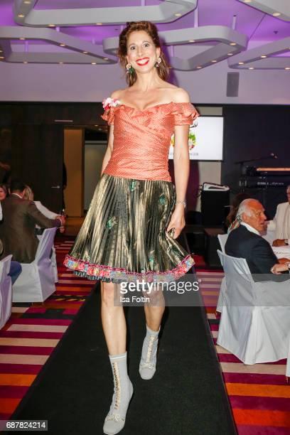 Dirndl designer Lola Paitinger walks the runway during the Kempinski Fashion Dinner on May 23 2017 in Munich Germany
