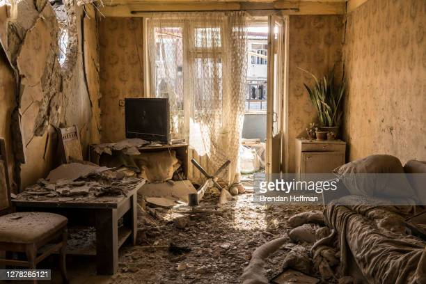 Dirt and debris covers the floor in an apartment on the top floor of a building that was shelled the previous evening on October 3, 2020 in...