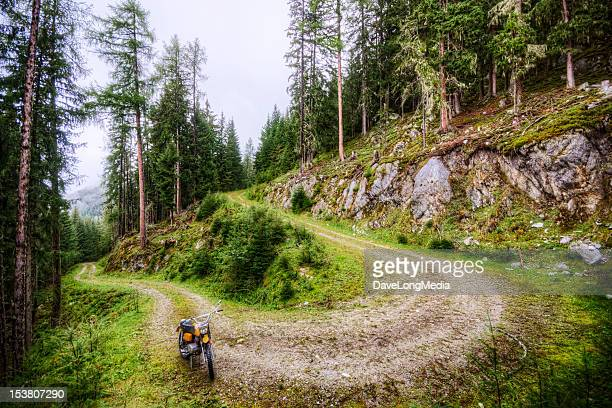 dirt bike and winding road in the alps - dirt track stock pictures, royalty-free photos & images
