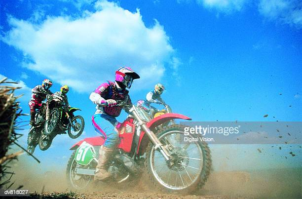 dirt bike race - motorcycle racing stock pictures, royalty-free photos & images