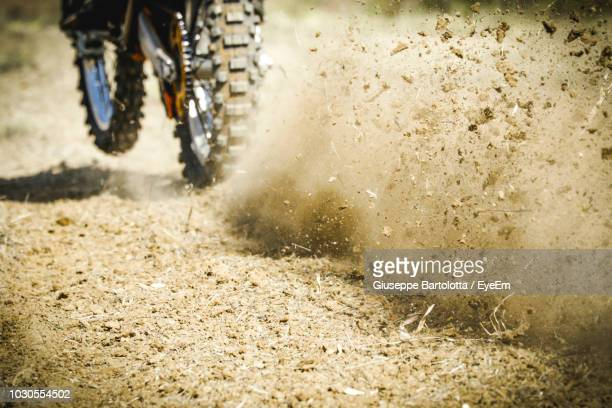 dirt by motorcycle on field - scrambling stock photos and pictures