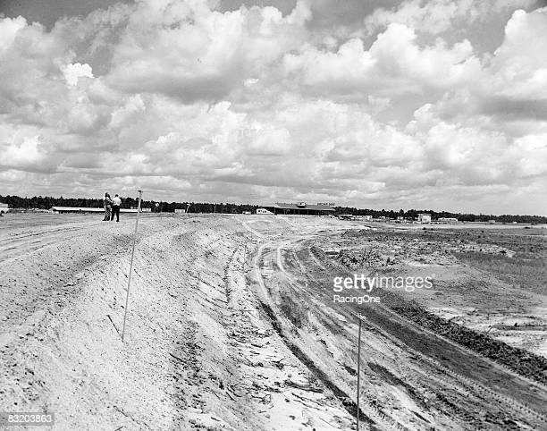 Dirt dredged from what would become Lake Lloyd was used to give rise to Daytona's steep 31degree banking Construction equipment frequently battled...