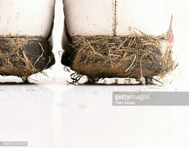Dirt encrusted golf shoes, close-up, rear view
