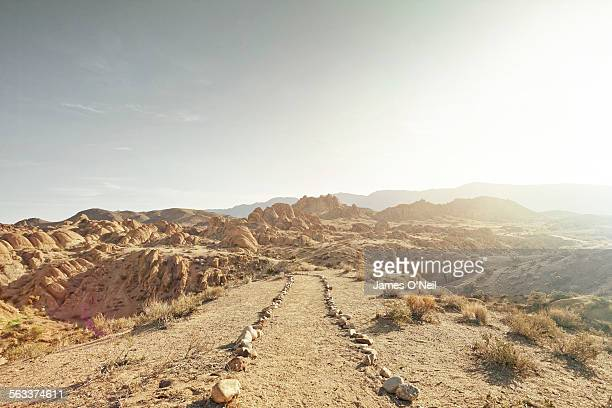 dirt path leading to rocky landscape - extreme terrain stock pictures, royalty-free photos & images